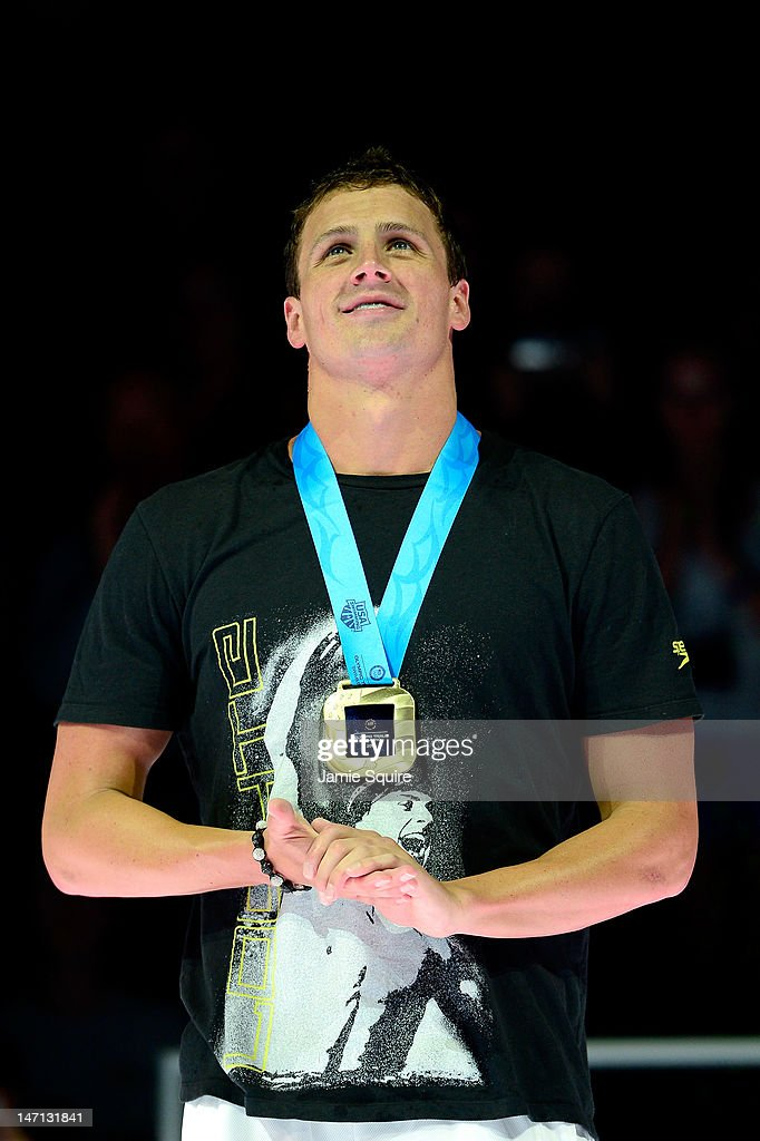Ryan Lochte celebrates after he received his gold medal for finishing first in the championship final heat of the Men's 400 m Individual Medely during the 2012 U.S. Olympic Swimming Team Trials at CenturyLink Center on June 25, 2012 in Omaha, Nebraska.