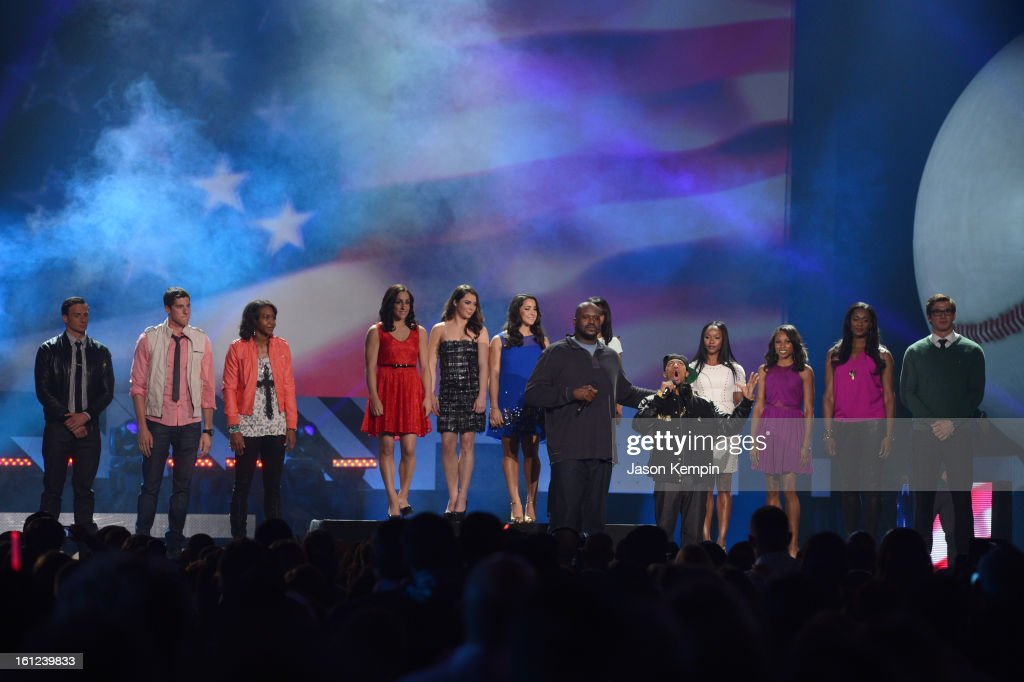 Ryan Lochte, Conor Dwyer, Tamika Catchings, Jordyn Wieber, McKayla Maroney, Aly Raisman, Shaquille O'Neal, co-host Nick Cannon, Carmelita Jeter, Allyson Felix, Swin Cash and Nathan Adrian stand onstage at the Third Annual Hall of Game Awards hosted by Cartoon Network at Barker Hangar on February 9, 2013 in Santa Monica, California. 23270_003_JK_0998.JPG