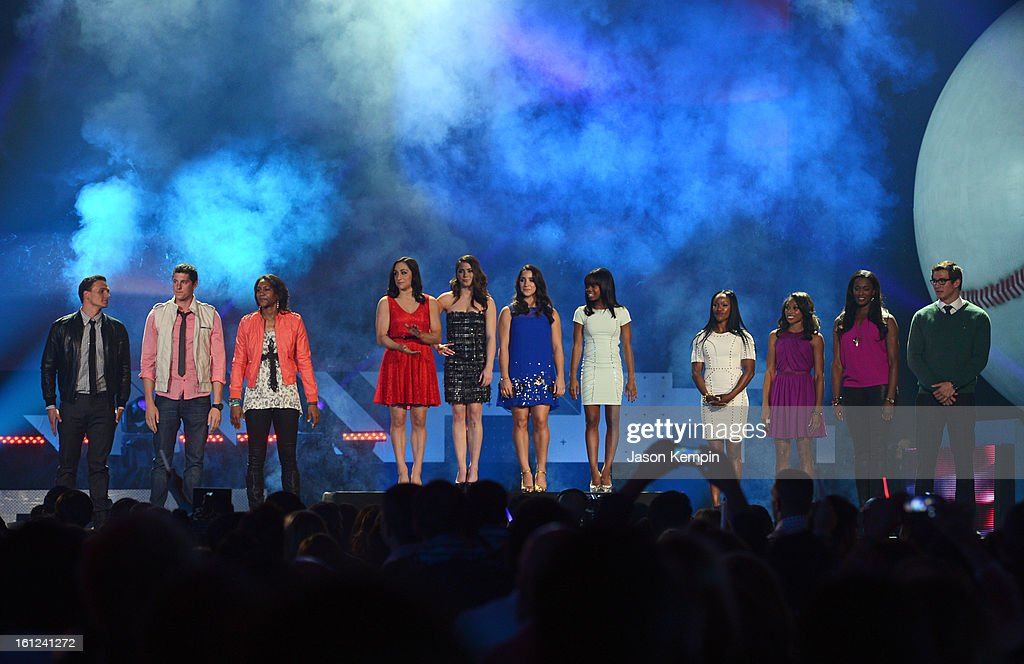 Ryan Lochte, Conor Dwyer, Tamika Catchings, Jordyn Wieber, McKayla Maroney, Aly Raisman, Gabby Douglas, Carmelita Jeter, Allyson Felix, Swin Cash and Nathan Adrian stand onstage at the Third Annual Hall of Game Awards hosted by Cartoon Network at Barker Hangar on February 9, 2013 in Santa Monica, California. 23270_003_JK_0983.JPG