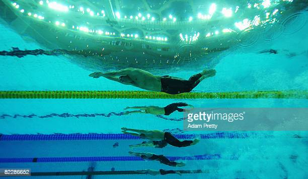 Ryan Lochte of the United States and Tamas Kerekjarto of Hungary competes in the Men's 200m Individual Medley Heat 5 held at the National Aquatics...