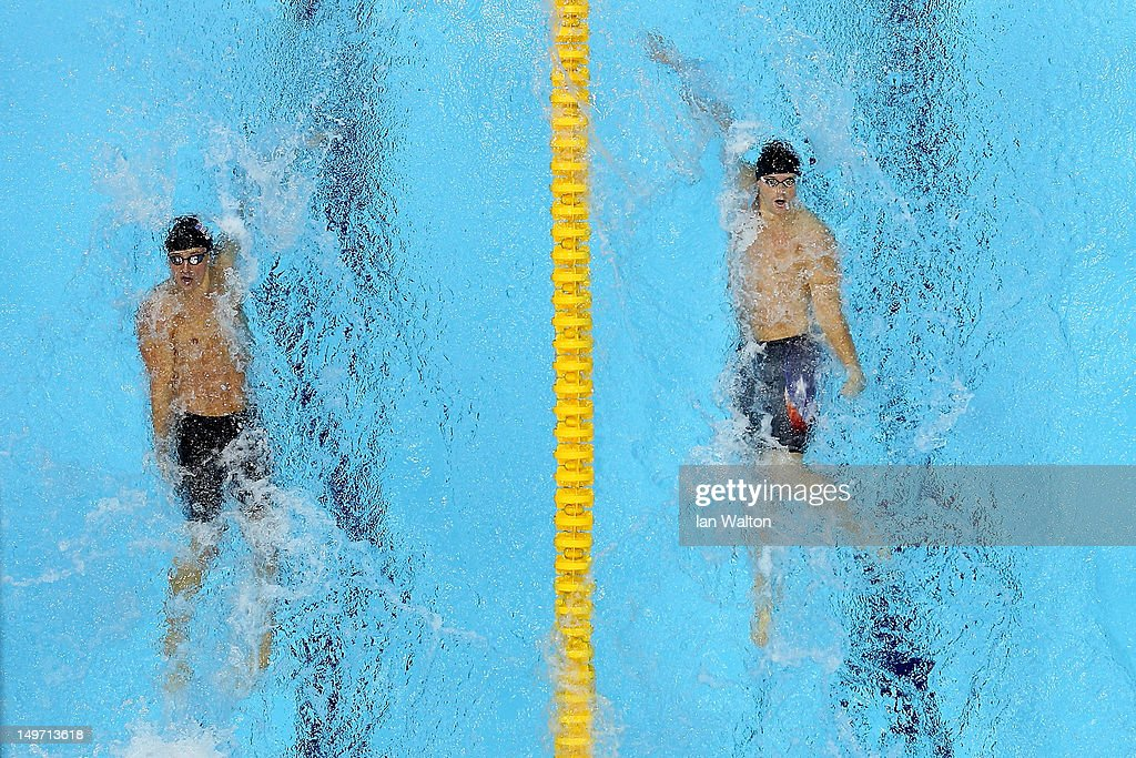 <a gi-track='captionPersonalityLinkClicked' href=/galleries/search?phrase=Ryan+Lochte&family=editorial&specificpeople=182557 ng-click='$event.stopPropagation()'>Ryan Lochte</a> of the United States and <a gi-track='captionPersonalityLinkClicked' href=/galleries/search?phrase=Tyler+Clary&family=editorial&specificpeople=5419589 ng-click='$event.stopPropagation()'>Tyler Clary</a> of the United States compete in the Men's 200m Backstroke final on Day 6 of the London 2012 Olympic Games at the Aquatics Centre on August 2, 2012 in London, England.