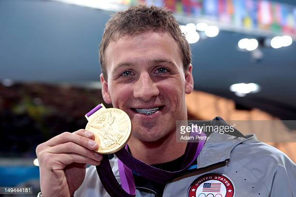 Ryan Lochte of the United States celebrates with his Gold Medal during the Medal Ceremony for the Men's 400m Individual Medley on Day 1 of the London...