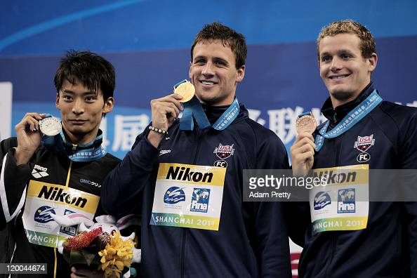 Ryan Lochte of the United States poses with his gold medal silver medalist Ryosuke Irie of Japan and bronze medalist Tyler Clary of the United States...