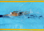 Ryan Lochte of the United States swims backstroke as he competes in heat five of the Men's 400m Individual Medley on Day One of the London 2012...
