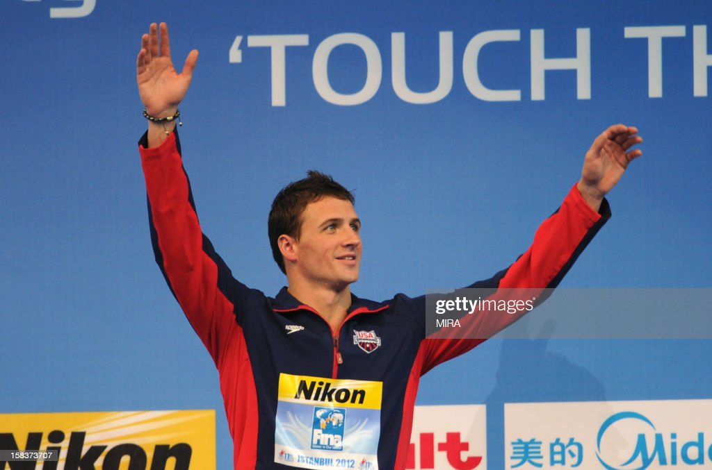 Ryan Lochte of the US celebrates on the podium after winning the men's 200m individual medley final during the FINA World Short Course Swimming Championships in Istanbul on December 14, 2012. Lochte set a new world record in the 200m individual medley at the world short course championships on Friday, winning the title in a time of 1min 49.63sec.