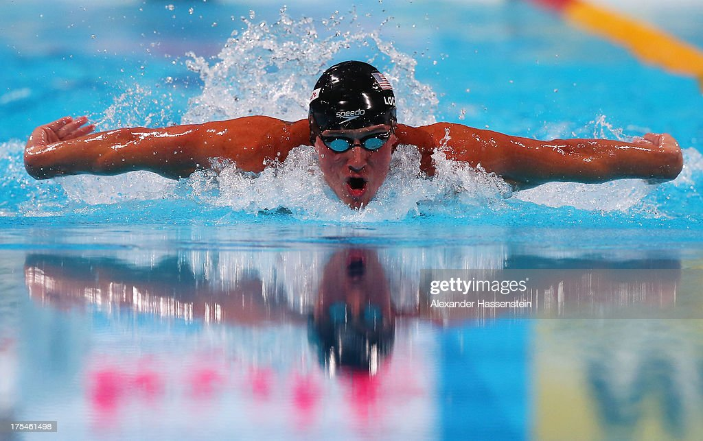 Ryan Lochte of the USA competes during the Swimming Men's Butterfly 100m Final on day fifteen of the 15th FINA World Championships at Palau Sant...