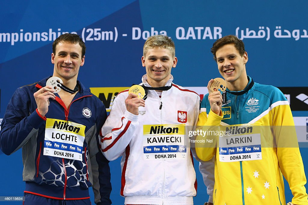 Ryan Lochte of the USA, Radoslaw Kawecki of Poland and Mitchell James Larkin of Australia celebrates on the podium after the Men's 200m Backstroke Finals during day five of the 12th FINA World Swimming Championships (25m) at the Hamad Aquatic Centre on December 7, 2014 in Doha, Qatar.