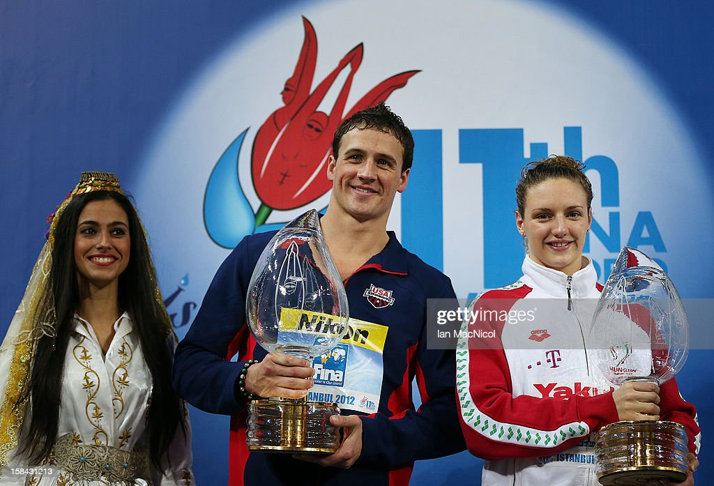 Ryan Lochte of USA and Katinka Hosszu of Hungary with the trophy for the most successful male and female swimmer over the Championships during day five of the 11th FINA Short Course World Championships at the Sinan Erdem Dome on December 16, 2012 in Istanbul, Turkey.