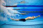 Ryan Lochte of USA competes in the Men's 200m Backstroke heats on day five of the 12th FINA World Swimming Championships at the Hamad Aquatic Centre...