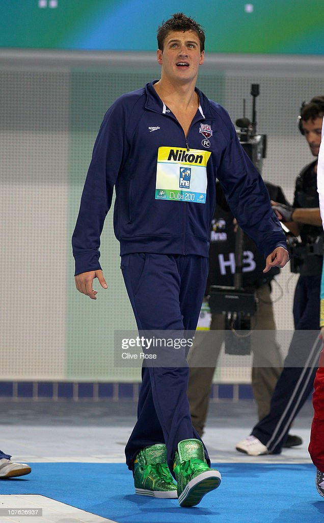 Ryan Lochte of USA makes his way to the podium to collect his Gold medal after winning the Men's 200m Freestyle final on day one of the 10th FINA World Swimming Championships (25m) at the Hamdan bin Mohammed bin Rashid Sports Complex on December 15, 2010 in Dubai, United Arab Emirates.