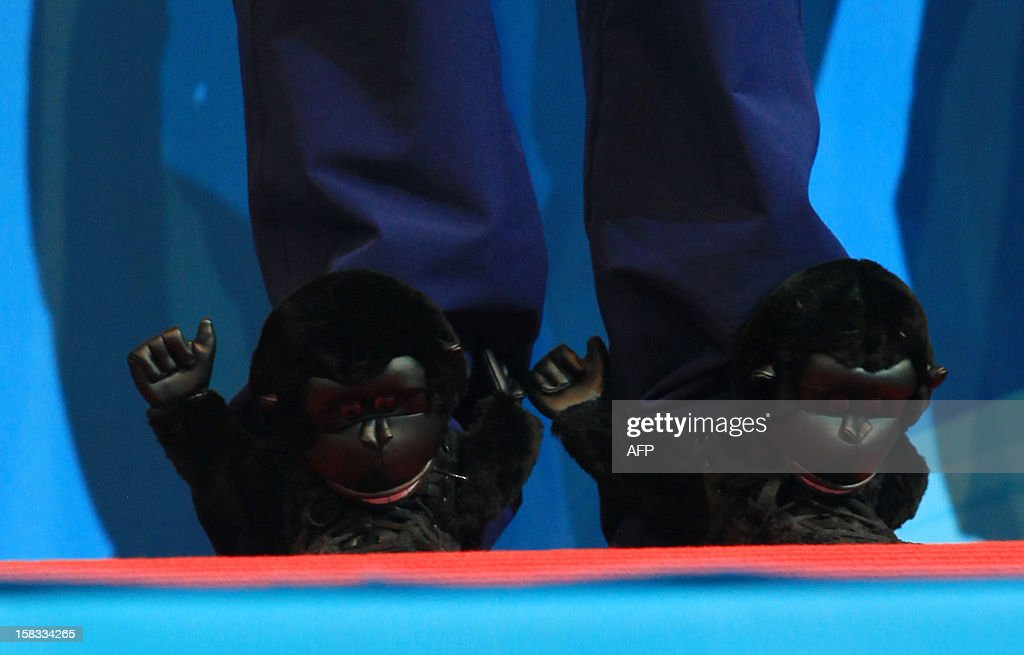 Ryan Lochte of USA stands on the podium wearing a pair of 'Monkey shoes' on December 13, 2012 during the FINA World Short Course Swimming Championships in Istanbul.