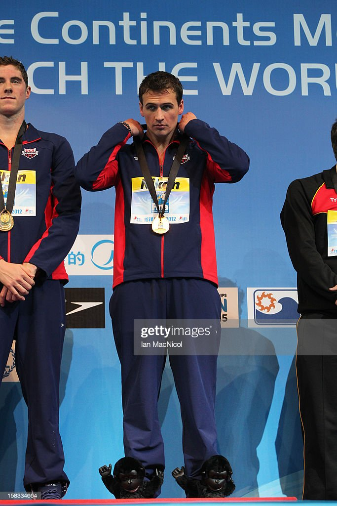 Ryan Lochte of USA stands on the podium wearing a pair of 'Monkey shoes' during day two of the FINA World Short Course Swimming Championships on December 13, 2012 in Istanbul, Turkey.
