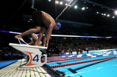 Ryan Lochte prepares to dive off of the starting block as he competes in the championship final of the Men's 200 m Freestyle during Day Three of the...