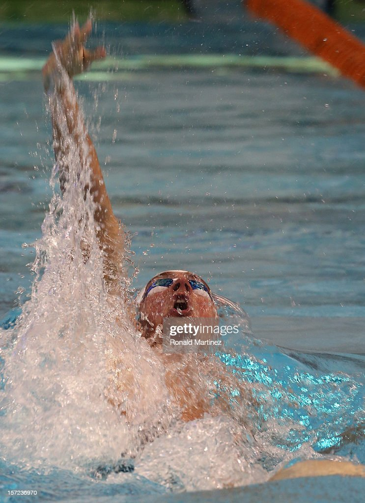Ryan Lochte swims in the Men's 100 Backstroke during day two of the 2012 AT&T Winter National Championships on November 30, 2012 at the Lee and Joe Jamail Texas Swimming Center in Austin, Texas.