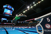 Ryan Lochteand and Chase Kalisz of the United States dive in to compete in the final heat for the Men's 400 Meter Individual Medley during Day One of...
