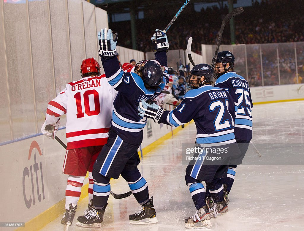 Ryan Lomberg #7 of the Maine Black Bears celebrates his goal with teammates Cam Brown #21 and Eric Schurhamer #25 during NCAA hockey action against the Boston University Terriers in the 'Citi Frozen Fenway 2014' at Fenway Park on January 11, 2014 in Boston, Massachusetts.