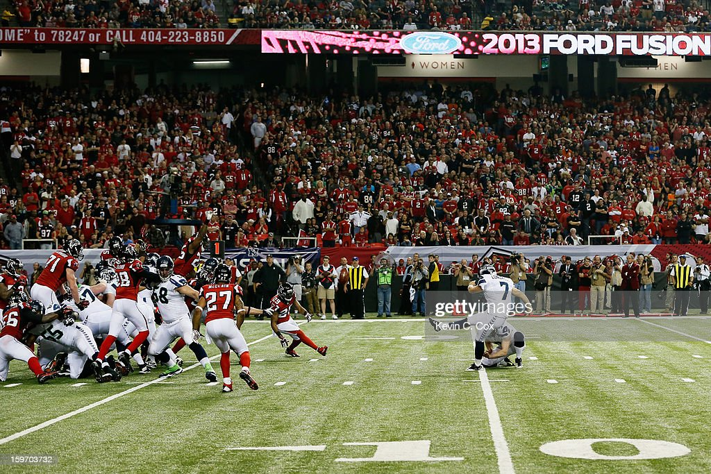 Ryan Longwell #7 of the Seattle Seahawks kicks an extra point against the Atlanta Falcons during the NFC Divisional Playoff Game at Georgia Dome on January 13, 2013 in Atlanta, Georgia.