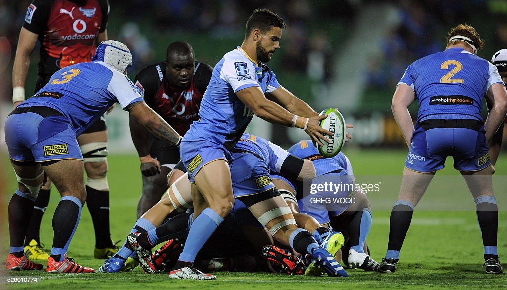 Ryan Louwrens (C) from Western Force kicks the ball clear during the Super Rugby match between Australias Western Force and South Africas Bulls in Perth on April 29, 2016. --IMAGE RESTRICTED TO EDITORIAL USE NO COMMERCIAL USE-- / AFP / Greg Wood