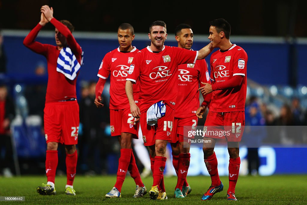 Ryan Lowe (centre) and Adam Chicksen (right) of Milton Keynes Dons celebrate following the FA Cup with Budweiser Fourth Round match between Queens Park Rangers and Milton Keynes Dons at Loftus Road on January 26, 2013 in London, England.