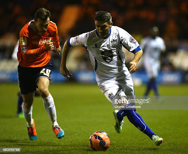 Ryan Lowe of Bury attacks past Luton's Shaun Whalley during the FA Cup Second Round Replay match between Luton Town and Bury at Kenilworth Road on...