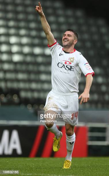 Ryan Lowe of Milton Keynes Dons celebrates after scoring his sides 1st goal during the npower League One match between Milton Keynes Dons and Walsall...