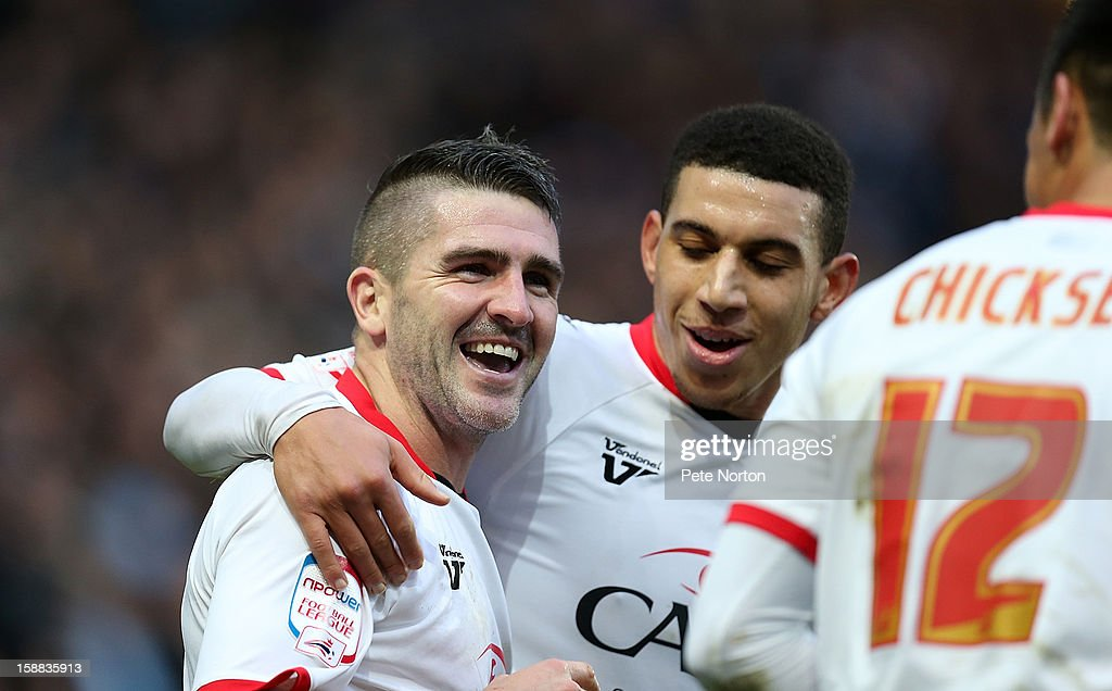 Ryan Lowe of Milton Keynes Dons is congratulated by team mates after scoring his sides 1st goal during the npower League One match between Milton Keynes Dons and Coventry City at Stadium mk on December 29, 2012 in Milton Keynes, England.