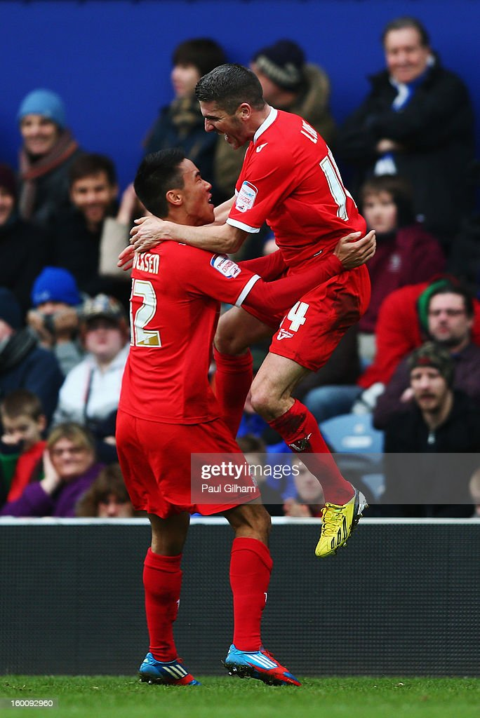 Ryan Lowe (R) of Milton Keynes Dons jumps into the arms of team mate Adam Chicksen (L) after scoring his sides second goal during the FA Cup with Budweiser Fourth Round match between Queens Park Rangers and Milton Keynes Dons at Loftus Road on January 26, 2013 in London, England.