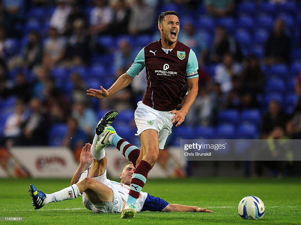 Ryan Lowe of Tranmere Rovers fouls Jason Shackell of Burnley during the pre season friendly match between Tranmere Rovers and Burnley at Prenton Park on July 23, 2013 in Birkenhead, England.