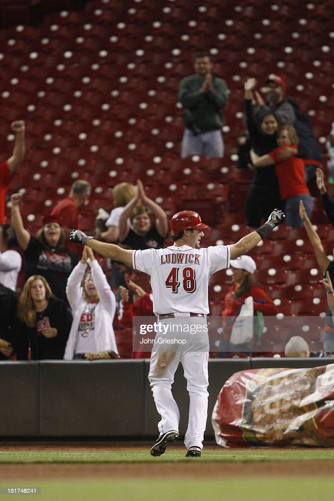 <a gi-track='captionPersonalityLinkClicked' href=/galleries/search?phrase=Ryan+Ludwick&family=editorial&specificpeople=834386 ng-click='$event.stopPropagation()'>Ryan Ludwick</a> #48 of the Cincinnati Reds celebrates connecting for a game winning RBI single during the game against the Pittsburgh Pirates at Great American Ball Park on September 10, 2012 in Cincinnati, Ohio. The Reds defeated the Pirates 4-3 in 14 innings.