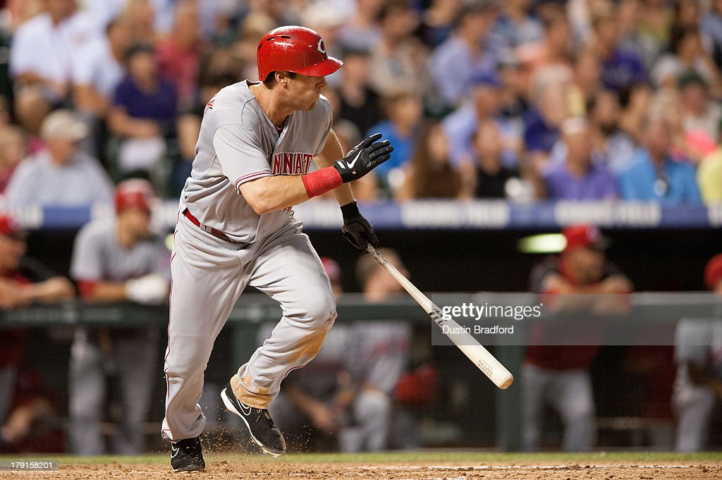 <a gi-track='captionPersonalityLinkClicked' href=/galleries/search?phrase=Ryan+Ludwick&family=editorial&specificpeople=834386 ng-click='$event.stopPropagation()'>Ryan Ludwick</a> #48 of the Cincinnati Reds hits a two-run single in the fifth inning of a game against the Colorado Rockies at Coors Field on August 31, 2013 in Denver, Colorado. The Reds beat the Rockies 8-3.
