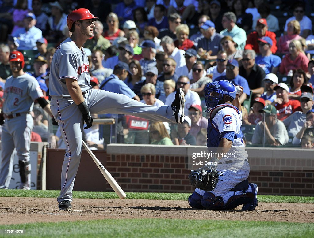<a gi-track='captionPersonalityLinkClicked' href=/galleries/search?phrase=Ryan+Ludwick&family=editorial&specificpeople=834386 ng-click='$event.stopPropagation()'>Ryan Ludwick</a> #48 of the Cincinnati Reds reacts to swinging and missing during the eighth inning against the Chicago Cubs on August 14, 2013 at Wrigley Field in Chicago, Illinois.