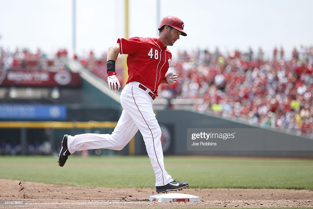 Ryan Ludwick #48 of the Cincinnati Reds rounds the bases after hitting a home run in the third inning of the game against the Chicago Cubs at Great American Ball Park on July 10, 2014 in Cincinnati, Ohio.