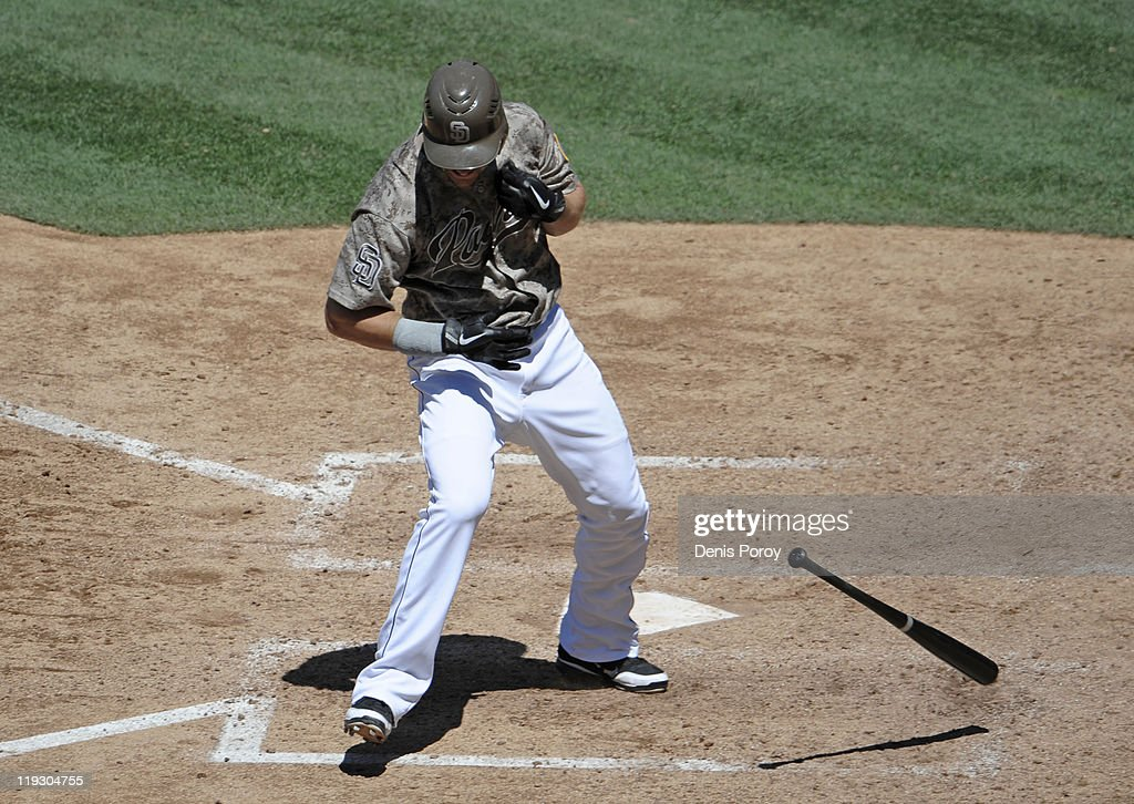 <a gi-track='captionPersonalityLinkClicked' href=/galleries/search?phrase=Ryan+Ludwick&family=editorial&specificpeople=834386 ng-click='$event.stopPropagation()'>Ryan Ludwick</a> #47 of the San Diego Padres drops the bat as he's hit with a pitch during the sixth inning of a baseball game against the San Francisco Giants at Petco Park on July 17, 2011 of the San Francisco Giants in San Diego, California.
