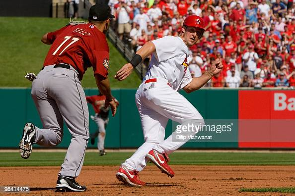 Ryan Ludwick of the St Louis Cardinals is caught in a rundown against Pedro Feliz of the Houston Astros in the home opener at Busch Stadium on April...