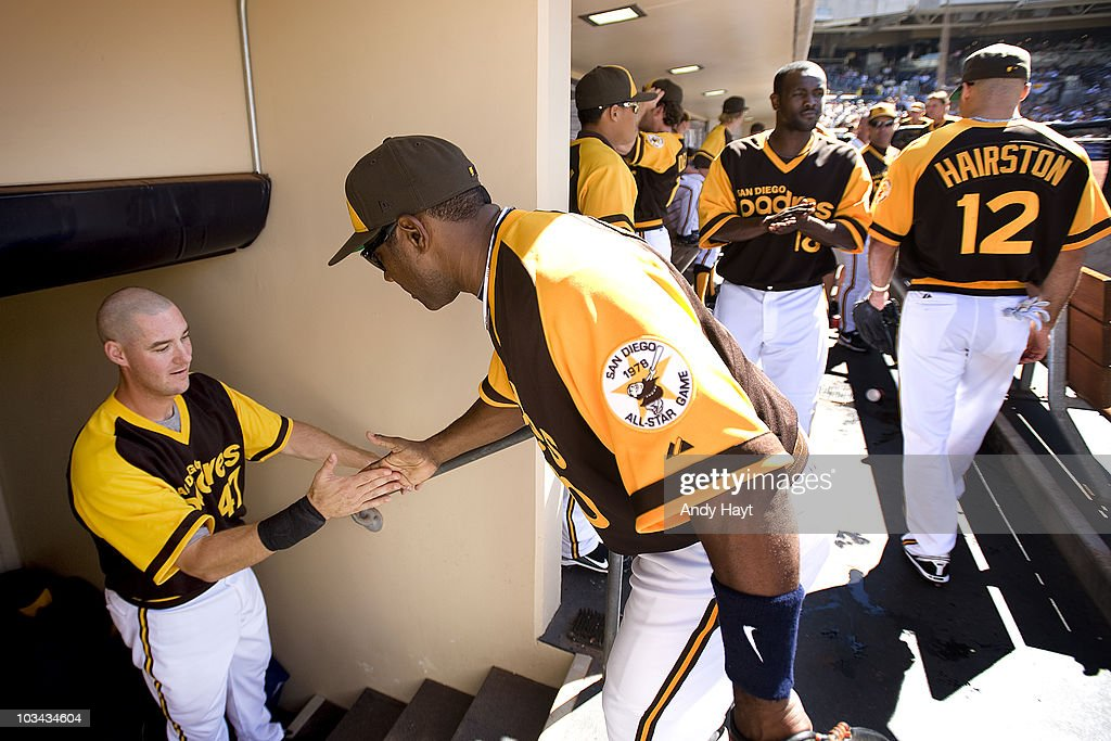 Ryan Ludwick slaps hands with Miguel Tejada of the San Diego Padres prior to the game against the Pittsburgh Pirates at Petco Park on Thursday August...