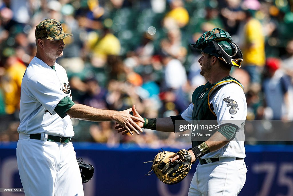 <a gi-track='captionPersonalityLinkClicked' href=/galleries/search?phrase=Ryan+Madson&family=editorial&specificpeople=550315 ng-click='$event.stopPropagation()'>Ryan Madson</a> #44 of the Oakland Athletics celebrates with <a gi-track='captionPersonalityLinkClicked' href=/galleries/search?phrase=Stephen+Vogt&family=editorial&specificpeople=7511888 ng-click='$event.stopPropagation()'>Stephen Vogt</a> #21 after the game against the Minnesota Twins at the Oakland Coliseum on May 30, 2016 in Oakland, California. The Oakland Athletics defeated the Minnesota Twins 3-2.