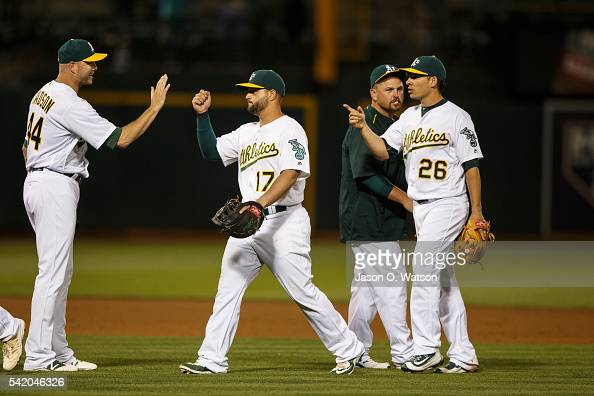 Ryan Madson of the Oakland Athletics Yonder Alonso Danny Valencia and Billy Butler celebrate after the game against the Milwaukee Brewers at the...