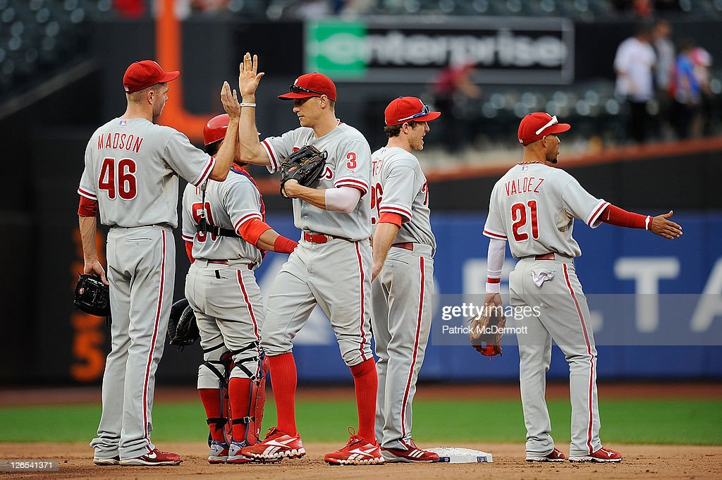 Ryan Madson #46 of the Philadelphia Phillies celebrates with his teammates after defeating the New York Mets at Citi Field on September 25, 2011 in the Flushing neighborhood of the Queens borough of New York City.