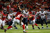 Ryan Mallett of the Houston Texans throws a pass under pressure from Kroy Biermann of the Atlanta Falcons in the first half at the Georgia Dome on...