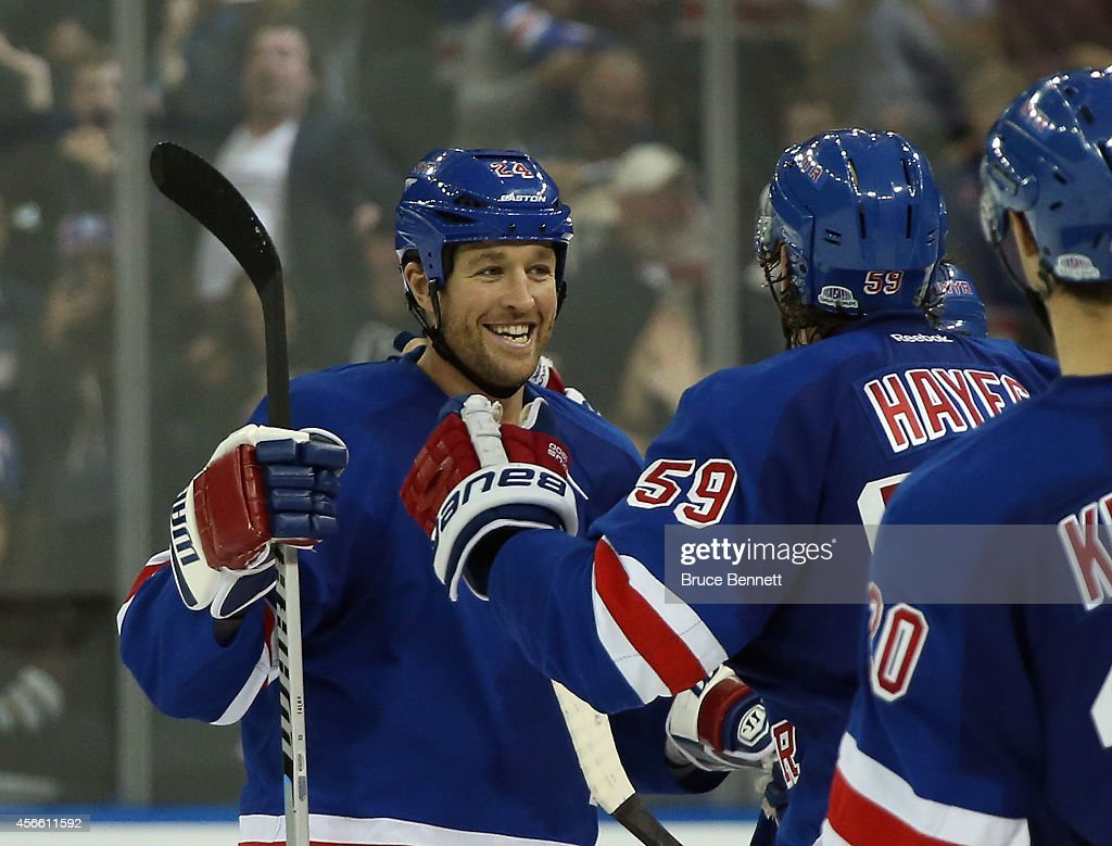 Ryan Malone #24 of the New York Rangers (L) celebrates his game winning shootout goal with Kevin Hayes #59 against the Chicago Blackhawks at Madison Square Garden on October 3, 2014 in New York City. The Rangers defeated the Blackhawks 3-2 in the shootout.