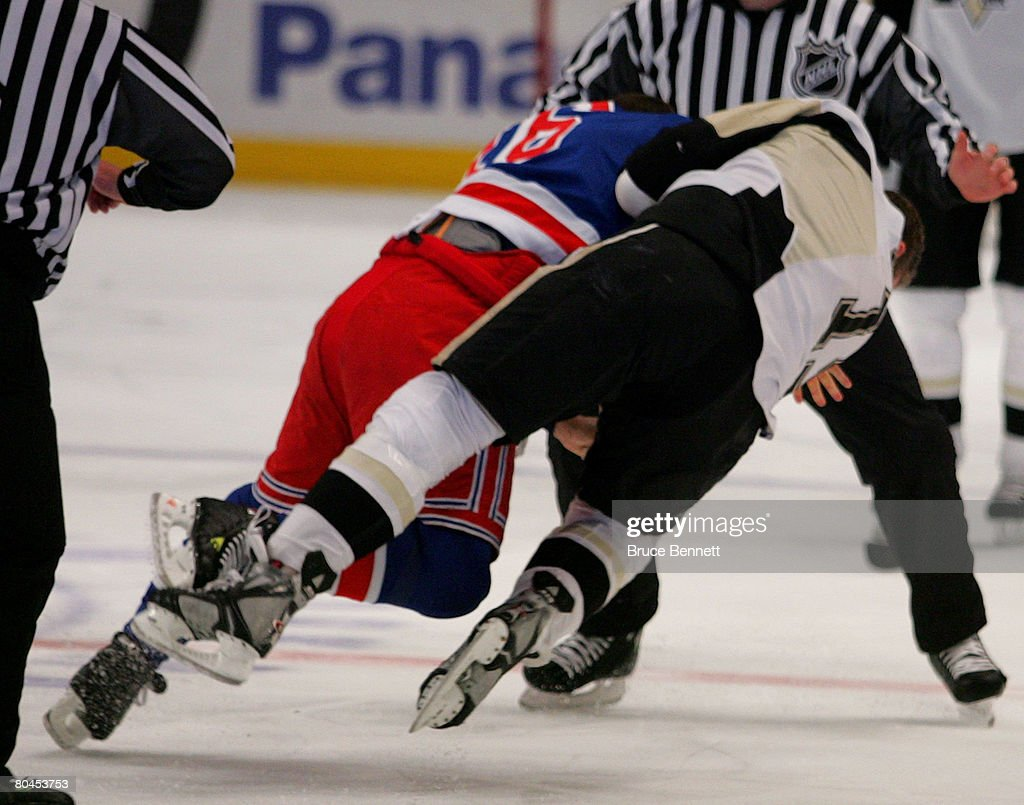 Ryan Malone of the Pittsburgh Penguins and Sean Avery of the New York Rangers fight during the first period on March 31 2008 at Madison Square Garden...