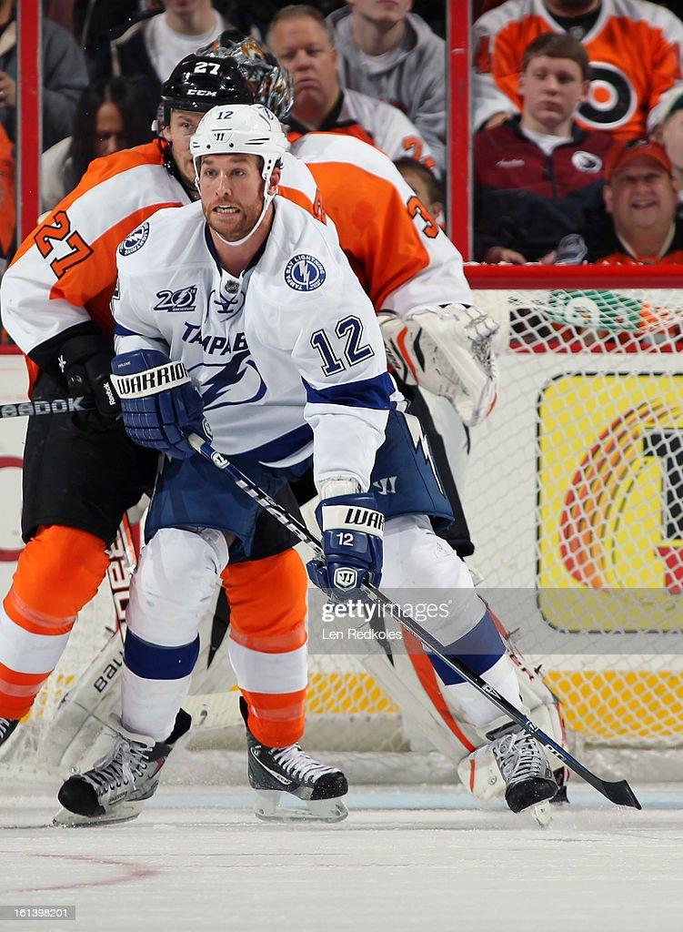 Ryan Malone #12 of the Tampa Bay Lightning battles against Bruno Gervais #27 the Philadelphia Flyers on February 5, 2013 at the Wells Fargo Center in Philadelphia, Pennsylvania.