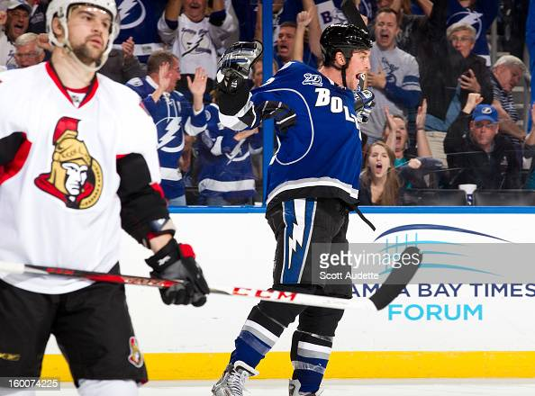 Ryan Malone of the Tampa Bay Lightning celebrates his gamewinning goal against the Ottawa Senators at the Tampa Bay Times Forum on January 25 2013 in...