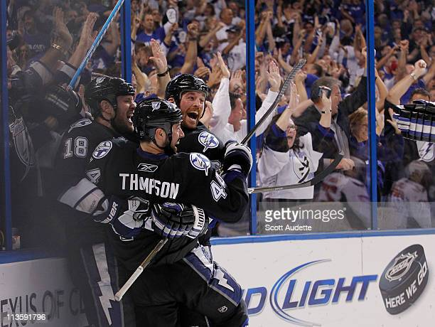 Ryan Malone of the Tampa Bay Lightning celebrates his goal with teammates Adam Hall and Nate Thompson during the third period against the Washington...