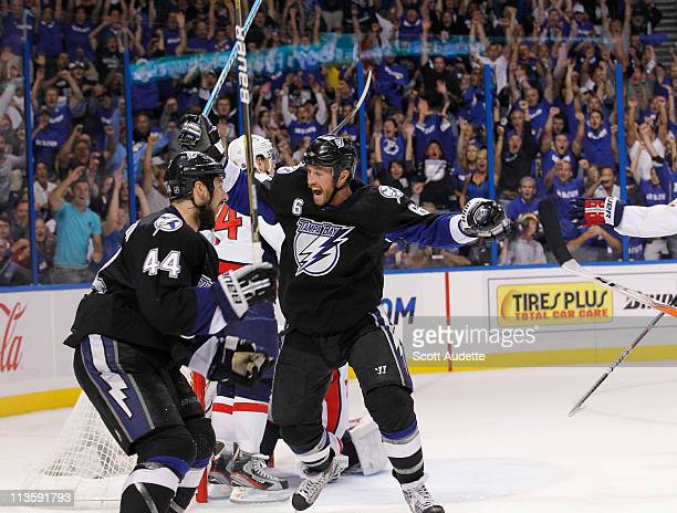 Ryan Malone of the Tampa Bay Lightning celebrates his goal with teammate Nate Thompson during the the third period against the Washington Capitals in...