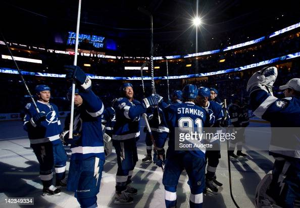 Ryan Malone of the Tampa Bay Lightning celebrates with teammates after winning the game against the Washington Capitals at the St Pete Times Forum on...