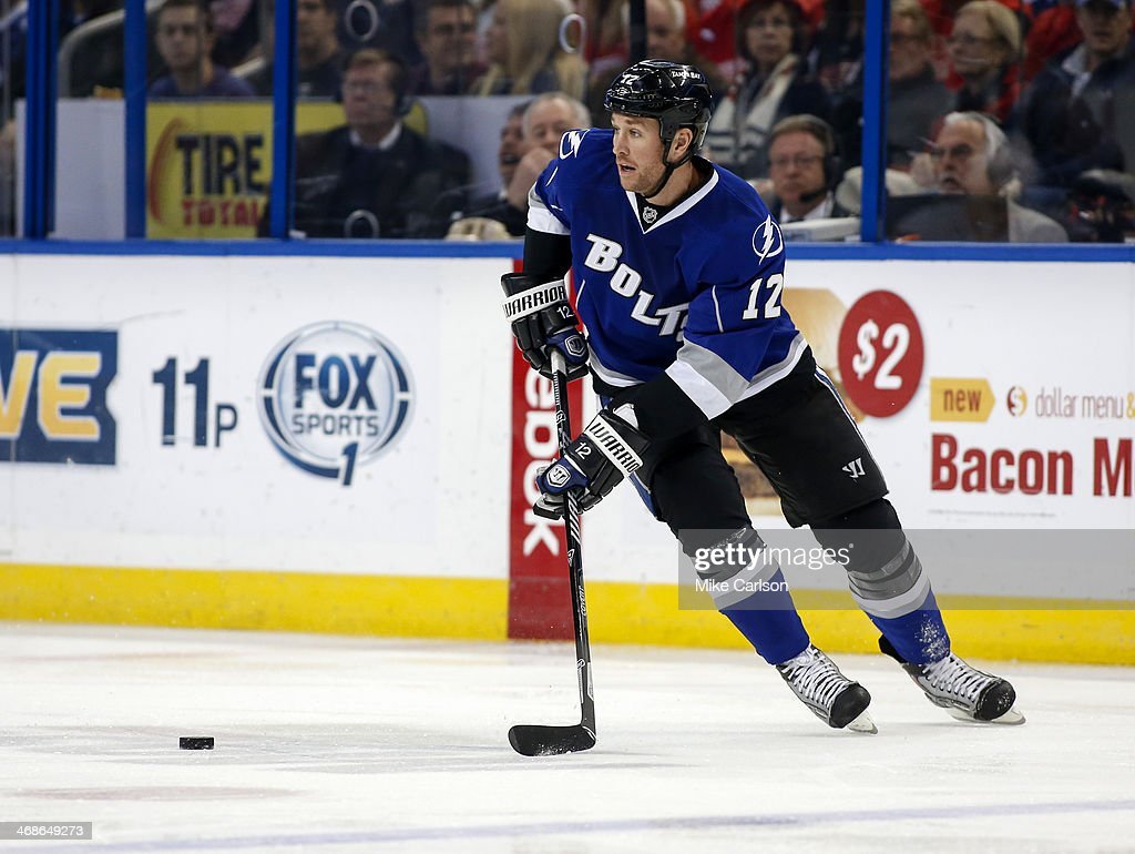 Ryan Malone of the Tampa Bay Lightning looks to pass against the Detroit Red Wings at the Tampa Bay Times Forum on February 8 2014 in Tampa Florida
