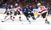 Ryan Malone of the Tampa Bay Lightning races for the puck as Bryce Salvador of the New Jersey Devils controls it during the first period at the Tampa...