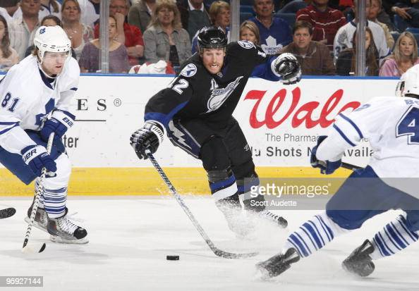 Ryan Malone of the Tampa Bay Lightning reaches for the puck against the Toronto Maple Leafs at the St Pete Times Forum on January 21 2010 in Tampa...