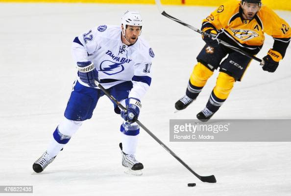 Ryan Malone of the Tampa Bay Lightning skates against the Nashville Predators at Bridgestone Arena on February 27 2014 in Nashville Tennessee